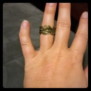 Women's gold colored feather ring.